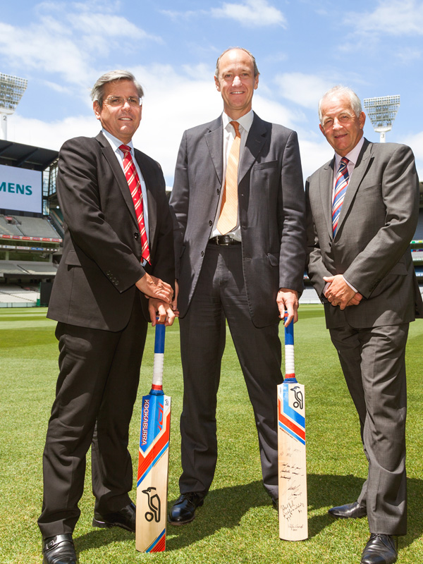 MCC CEO Stephen Gough (right) with Siemens representatives at the MCG in November 2014.